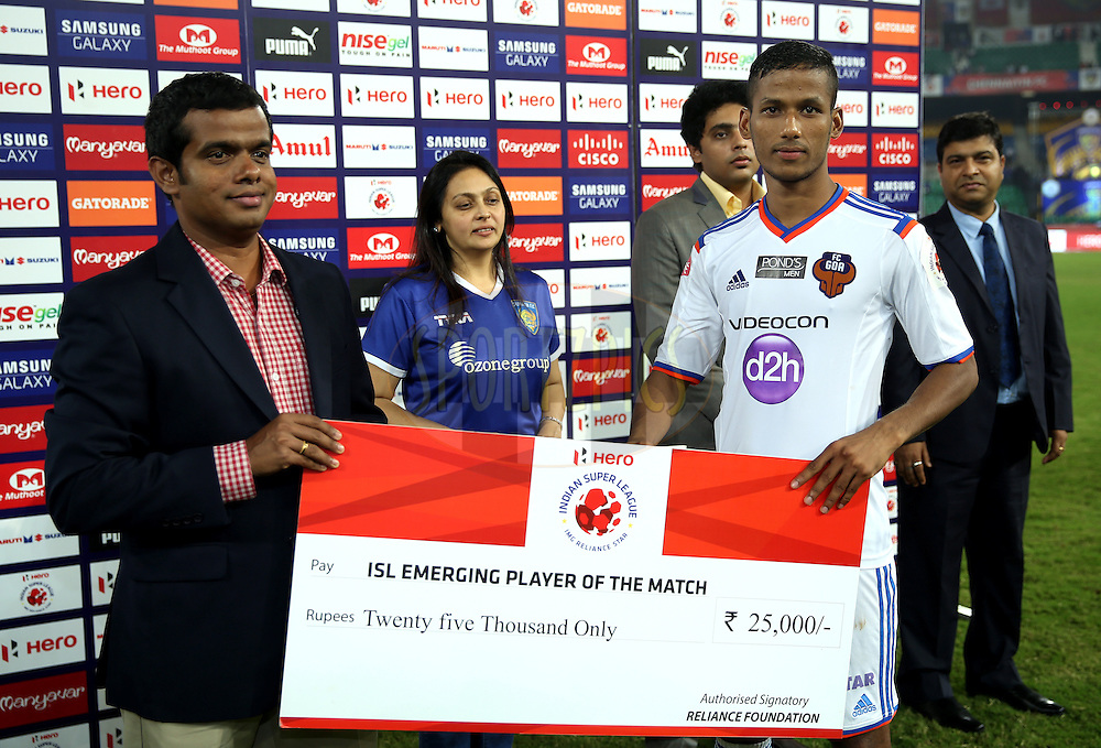 Narayan Das of FC Goa recives ISL emerging player of the match  during the presentation of the match 50 of the Hero Indian Super League between Chennaiyin FC and FC Goa held at the Jawaharlal Nehru Stadium, Chennai, India on the 5th December 2014.<br /> <br /> Photo by:  Sandeep Shetty/ ISL/ SPORTZPICS