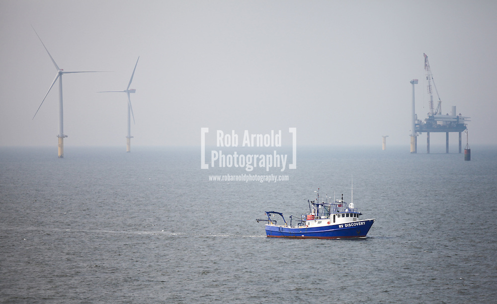 © Rob Arnold.  28/03/2014. North Wales, UK. Survey vessel, RV Discovery, on the Gwynt y Môr Offshore Wind Farm off the coast of North Wales. Photo credit : Rob Arnold