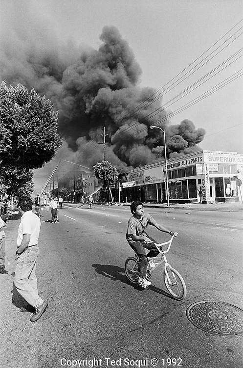 Businesses burn and are looted in the mostly hispanic area of Los Angeles, Pico/Union.