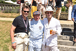 Mark Stewart, Sir Jackie Stewart and Paul Stewart at the 'Cartier Style et Luxe' enclosure during the Goodwood Festival of Speed, Goodwood House, West Sussex, England. 15 July 2018.