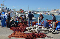Fishermen repair fishing nets, quay, Mediterranean, Mediterraneo, Estepona, Malaga, Andalucia, Andalusia, Spain, Espana, Costa del Sol, tourism, travel, holidays, 201302201115..Copyright Image from Victor Patterson, 54 Dorchester Park, Belfast, UK, BT9 6RJ..Tel: +44 28 9066 1296.Mob: +44 7802 353836.Voicemail +44 20 8816 7153.Skype: victorpattersonbelfast.Email: victorpatterson@me.com.Email: victorpatterson@ireland.com (back-up)..IMPORTANT: If you wish to use this image or any other of my images please go to www.victorpatterson.com and click on the Terms & Conditions. Then contact me by email or phone with the reference number(s) of the image(s) concerned.