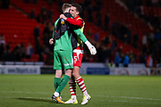 Doncaster Rovers goalkeeper Ian Lawlor (1) and Doncaster Rovers defender Mathieu Baudry (5) hug at the end of the game,  after their mix costs Doncaster Rovers a goal to make the score 2-1 during the EFL Sky Bet League 1 match between Doncaster Rovers and Portsmouth at the Keepmoat Stadium, Doncaster, England on 17 October 2017. Photo by Simon Davies.