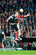 04.09.2015. Copenhagen, Denmark. <br /> Nicklas Bendtner (R) of Denmark fights for the ball with                     Arlind Ajeti (L) of Albania during their UEFA European Champions qualifying round match at the Parken Stadium. Photo: © Ricardo Ramirez.