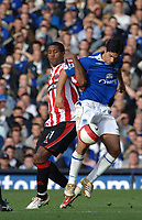 Photo: Paul Greenwood.<br />Everton v Sheffield United. The Barclays Premiership. 21/10/2006. Sheffield's Mikel Leigertwood, left and  Everton's Tim Cahill battle for the ball.