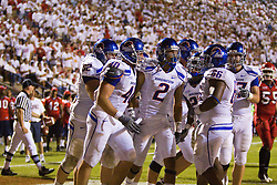 Sep. 18, 2009; Fresno, CA, USA;  Boise State wide receiver Austin Pettis (2) celebrates with teammates tight end Richie Brockel (40) and center Thomas Byrd (66) after a touchdown during the fourth quarter at Bulldog Stadium. Boise State defeated Fresno State 51-34.