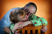 Curls kissing Marsha, man kissing his wife's neck