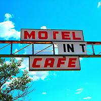Old broken cafe sign