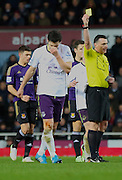 18. Gareth Barry (Everton) yellow card during the The FA Cup match between West Ham United and Everton at the Boleyn Ground, London, England on 13 January 2015. Photo by Matthew Redman.