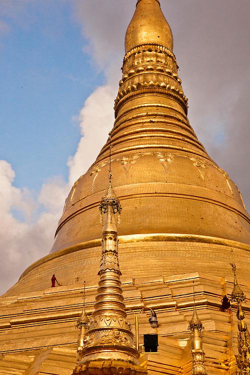 Monks walking high up on the Shwedagon Pagoda, Yangon, Myanmar.