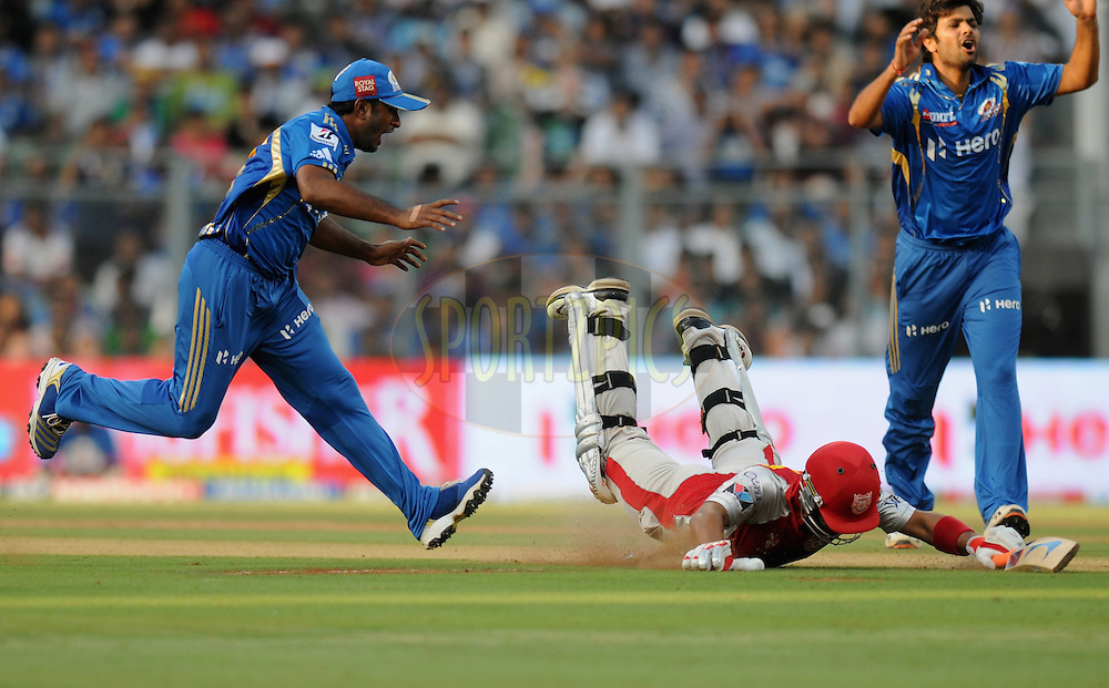 Ambati Raydu of Mumbai Indians tries to hit the stump as Mandeep Singh of Kings XI Punjab slides to reach the crease during match 28 of the Indian Premier League ( IPL) 2012  between The Mumbai Indians and the Kings X1 Punjab held at the Wankhede Stadium in Mumbai on the 22nd April 2012..Photo by Pal Pillai/IPL/SPORTZPICS.
