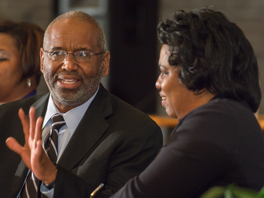 Prairie View A&M president Dr. George C. Wright, left, talks with Houston ISD Trustee Paula Harris, right,  during a media conference announcing a partnership between Jones Futures Academy and the Prairie View A&M Nursing School, April 15, 2015.