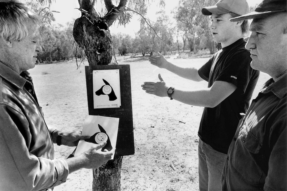 'Kangaroo Harvesting' ..Tom Garrett, Project Officer for the MWGH conducts an accuracy test with roo shooter Terry Brady for a Kangaroo shooters licence in Hebel, Queensland. Terry is watched by his father Alan.