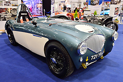 © Licensed to London News Pictures. 18/02/2016. A stand displaying a restored Austin Healey car at the launch of the London Classic Car Show.  The four day event brings together classic car owner, dealers, collectors, experts and enthusiasts. London, UK. Photo credit: Ray Tang/LNP