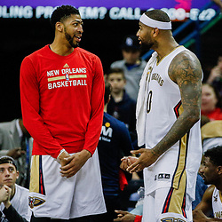 Mar 14, 2017; New Orleans, LA, USA; New Orleans Pelicans forward Anthony Davis and forward DeMarcus Cousins (0) talk on the bench during the fourth quarter of a game against the Portland Trail Blazers at the Smoothie King Center. The Pelicans defeated the Trail Blazers 100-77. Mandatory Credit: Derick E. Hingle-USA TODAY Sports
