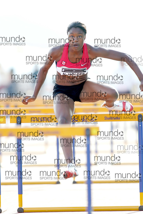 (Sherbrooke, Canada---21 July 2006) Nikkita Holder competing in the qualifying rounds of the 100m hurdles at the 2006 Canadian Junior Track and Field Championships 21-23 July 2006 held in Sherbrooke Quebec. Additional information can be found www.athletics.ca Copyright 2006 Sean Burges / Mundo Sport Images, www.mundosportimages.com