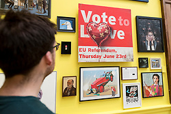 "© Licensed to London News Pictures. 05/06/2018. LONDON, UK. A staff member views ""Vote to Love"" by Bansky at a preview of the 250th Summer Exhibition at the Royal Academy of Arts in Piccadilly, which has been co-ordinated by Grayson Perry RA this year.  Running concurrently, is The Great Spectacle, featuring highlights from the past 250 years.  Both shows run 12 June to 19 August 2018.  Photo credit: Stephen Chung/LNP"