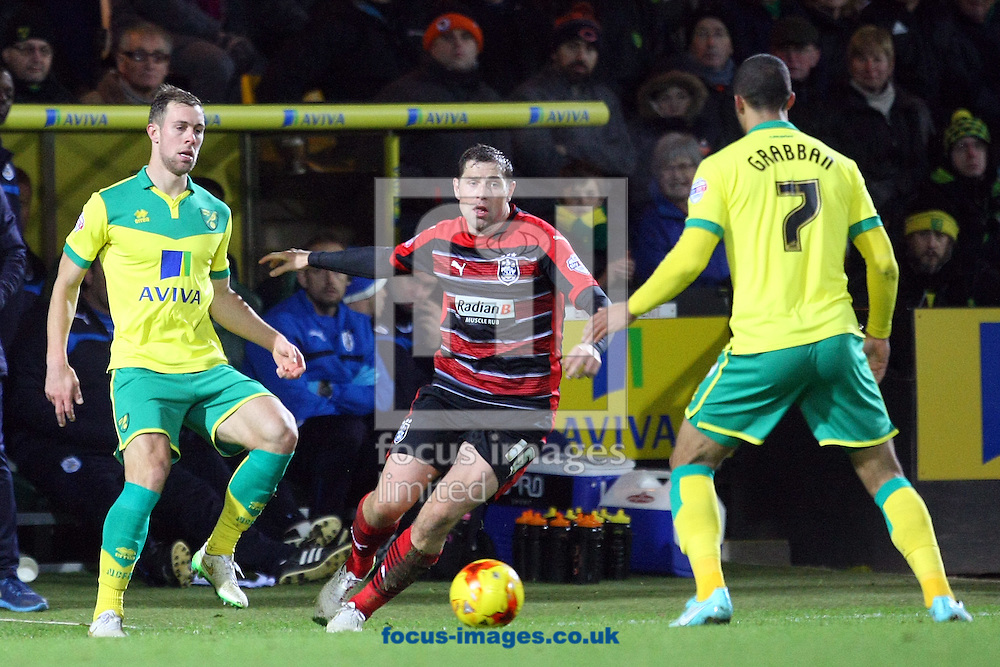 Grant Holt of Huddersfield Town in action during the Sky Bet Championship match at Carrow Road, Norwich<br /> Picture by Paul Chesterton/Focus Images Ltd +44 7904 640267<br /> 13/12/2014