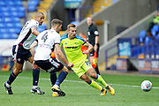 Derby County striker Andreas Weimann (19) is shadowed by Bolton Wanderers midfielder Darren Pratley (21) and Bolton Wanderers defender Dorian Dervite (4) during the EFL Sky Bet Championship match between Bolton Wanderers and Derby County at the Macron Stadium, Bolton, England on 19 August 2017. Photo by Craig Galloway.