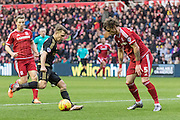 Nottingham Forest forward Jamie Ward (19) on the ball watched by Middlesbrough FC defender Fernando Amorebieta (5) during the Sky Bet Championship match between Middlesbrough and Nottingham Forest at the Riverside Stadium, Middlesbrough, England on 23 January 2016. Photo by George Ledger.