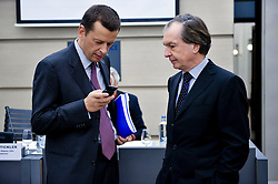 Dimitris  Panageas, member of the board of directors for the OPAP (Hellenic Organization of Football Prognostics S.A.) left, speaks with Fredrich Stickler, president of the European Lotteries and deputy chief executive officer of the Austrian Lotteries, right, prior to a news conference at the International Press Center in Brussels, Belgium, Thursday, Sept. 8, 2009. The European Lotteries, an umbrella organization of the EU national lotteries, celebrated a victory in the European Union's highest court, which ruled that EU member states can prohibit commercial online gambling operations from offering games of chance via the internet to their citizens, even when these operators are based and licensed in another EU member state. (Photo © Jock Fistick)