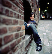 "Conor Oberst photographed in Seattle, WA.  October 17th, 2004 for the release of ""I'm Wide Awake, It's Morning"" and ""Digital Ash in a Digital Urn""."