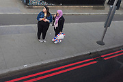 A young Muslim woman holds a Union Jack shopping bag on Westminster Bridge, in Lambeth, on 28th March 2019, in London, England