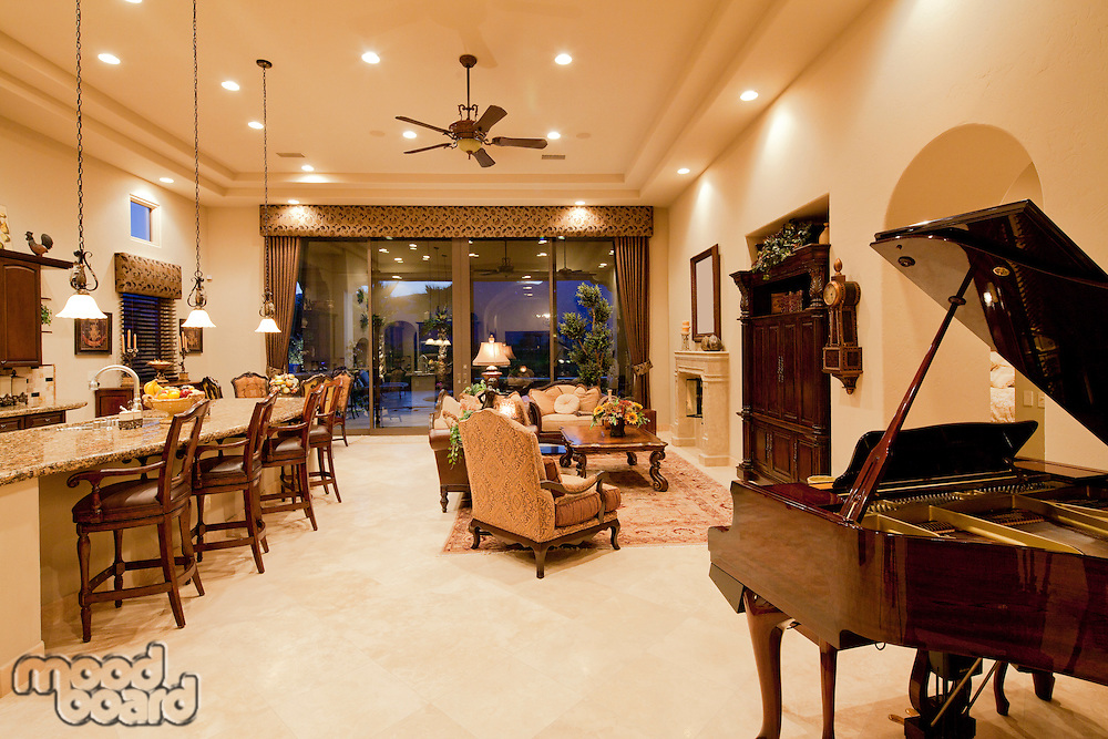 Luxury open plan living room kitchen with baby grand piano