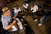 Canadian artist Dave Bidini (left) jams with members of the band King's Jubilee, (from left to right) Zaroe Amilcar, Richard Neufville, Francis Wesseh and Terry Williams at the  Buduburam refugee settlement, roughly 20 km west of Ghana's capital Accra on Friday April 13, 2007. The group, which is composed of five Liberian men living at Buduburam, is currently recording their second album, and already has a growing number of fans back in Liberia. The Buduburam refugee settlement is still home over 30,000 Liberians, most of which have mixed feelings about returning to Liberia..