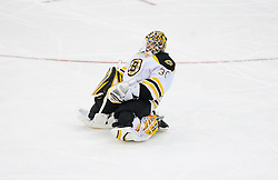Dec 23, 2008; Newark, NJ, USA; Boston Bruins goalie Tim Thomas (30) stretches during the second period at the Prudential Center.