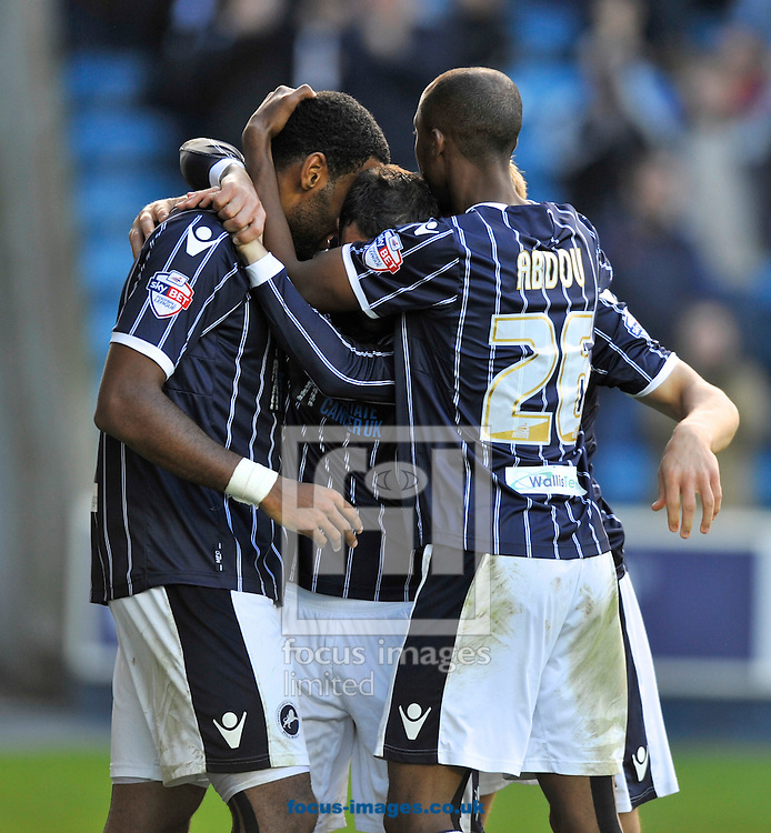 Picture by Alan Stanford/Focus Images Ltd +44 7915 056117<br />19/10/2013<br />Millwall players celebrate their equaliser during the Sky Bet Championship match at The Den, London.
