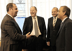 Peer Steinbrueck, Germany's finance minister, center left, laughs with Josef Proell, Austria's finance minister, left, Franc Krizanic, Slovenia's finance minister, center right, and Charilaos Stavrakis, the finance minister of Cyprus, far right, during the Eurogroup meeting at EU headquarters in Brussels, Monday, July 6, 2009. (Photo © Jock Fistick)