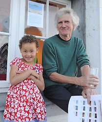 John Hensey pictured with his grandaughter Lat the opening of 'Silent Notes' an exhibition of new paintinfs by Deirdre Walsh at the Custom House Studios were Geraldine Mitchell, Deirdre Walsh, Margaret Duffy and Gemma Hensey. The exhibition continues until at the gallery until the 18th of September.<br />Pic Conor McKeown