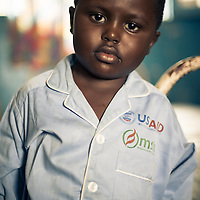 A young boy, photographed after his hernia operation.