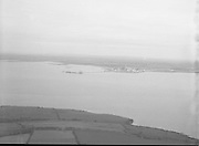 Aerial Views of Shannon Airport.     (N88)..1981..11.08.1981..08.11.1981..11th August 1981..Shannon Airport is situated in Co Clare in the west of Ireland. It is the best located airport in Ireland for tourism on the western seaboard, Kerry, Galway, The Burren etc...Series of aerial images of Shannon Airport and out into the Shannon Estuary taken from aboard an aircraft Photos, Photo, Snap, Streets, Street,