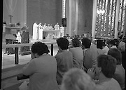 "Fr Niall O'Brien says Thanksgiving Mass.1984..16.07.1984..07.16.1984..16th July 1984..In celebration of his safe homecoming from the Philippines,Fr Niall O'Brien said a thanksgiving mass At Newtownpark Ave,Blackrock,Dublin. Along with two other priests and six lay people,Fr Niall was falsly accused of multiple murders.They became known as ""The Negros Nine"".After President Reagan visited Ireland,The American government put pressure on the Marcos regime and all charges were dropped and all were fully exonerated...Image of the congregation as the consecration. Fr O'Brien is joined by other Colomban fathers in con-celebration..Note; Fr O'Brien, who was born in Dublin in 1939,died in Pisa, Italy in 2004"