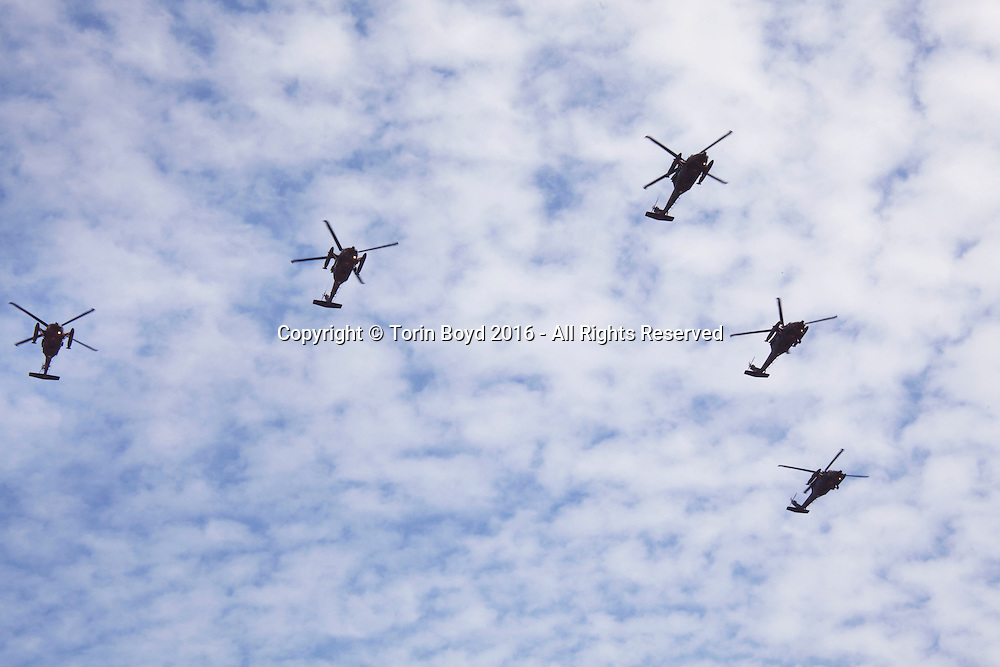 October, 23, 2016, Asaka, Saitama Prefecture, Japan: An overhead display by the Japan Air Self Defense Force helicopters was held during an annual military review held at the Asaka Training Area, a Japan Ground Self Defense Force (JSDF) military base on the outskirts of Tokyo. Blue Impulse is similar to America's Blue Angels and from 11 Squadron 4th Air Wing of the Japan Air Self Defense Force based at Matsushima Air Base. For this event, Prime Minister Shinzo Abe, top ranking Japanese brass and international dignitaries were in attendance to view Japan's military might. This included 4000 troops, 27 divisions, 280 vehicles and artillery, plus 50 aircraft of the Ground, Air, and Maritime branches of the JSDF. (Torin Boyd/Polaris).