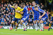 Scunthorpe's Paddy Madden & Chelsea's César Azpilicueta battle for the ball during the The FA Cup third round match between Chelsea and Scunthorpe United at Stamford Bridge, London, England on 10 January 2016. Photo by Shane Healey.