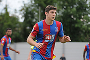Jake Gray watches the action unfold during the U21 Professional Development League match between Crystal Palace U21s and Huddersfield U21s at Imperial Fields, Tooting, United Kingdom on 7 September 2015. Photo by Michael Hulf.