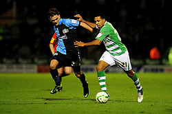 Wycombe Wanderers' Jess Kewley-Graham battles for possession with Yeovil Town's Korey Smith - Photo mandatory by-line: Dougie Allward/JMP  - Tel: Mobile:07966 386802 04/12/2012 - SPORT - FOOTBALL - Johnstone's Paint Trophy  -  Yeovil  -  Huish Park  -  Yeovil Town V Wycombe Wanderers