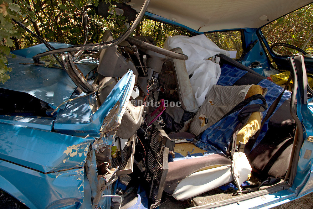 close up of a crashed car with roof cut open
