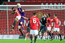 © Licensed to London News Pictures . 12/12/2016 . Manchester , UK . MUFC Captain TYRELL WARREN challenges Southampton keeper ALEX CULL . Manchester United vs Southampton FA Youth Cup Third Round match at Old Trafford . Photo credit : Joel Goodman/LNP