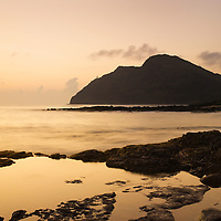 Dawn oceanscape, shoreline at Makapuu, lighthouse in distance
