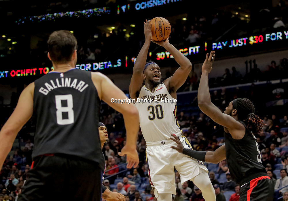Dec 3, 2018; New Orleans, LA, USA; New Orleans Pelicans forward Julius Randle (30) shoots over LA Clippers forward Montrezl Harrell (5) during the second half at the Smoothie King Center. Mandatory Credit: Derick E. Hingle-USA TODAY Sports