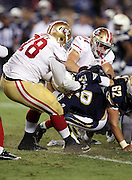 San Francisco 49ers linebacker Marcus Rush (44) and San Francisco 49ers defensive tackle Garrison Smith (78) gang tackle San Diego Chargers quarterback Mike Bercovici (6) causing a fumble recovered by the Niners in the fourth quarter during the 2016 NFL preseason football game against the San Diego Chargers on Thursday, Sept. 1, 2016 in San Diego. The 49ers won the game 31-21. (©Paul Anthony Spinelli)