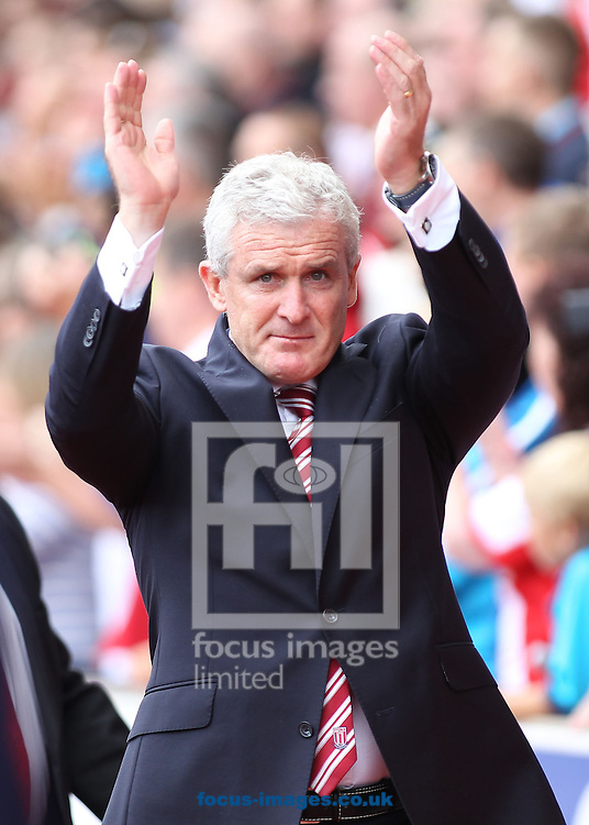 Mark Hughes, manager of Stoke City, on the touchline prior to the Barclays Premier League match against Aston Villa at the Britannia Stadium, Stoke-on-Trent.<br /> Picture by Michael Sedgwick/Focus Images Ltd +44 7900 363072<br /> 16/08/2014
