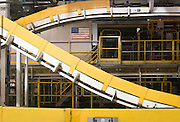 Flag displayed among the Conveyor Chain and Safety Guards