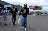 NEWS&GUIDE PHOTO / PRICE CHAMBERS.Stocking up on essentials like ice and coffee before embarking on a 3,000 mile trip home, Cesar and Hugo Marquina Corona and Juan Carlos Morales leave Cowboy Gas for the last time this season.