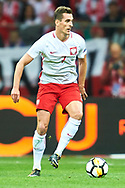 Warsaw, Poland - 2017 September 04: Arkadiusz Milik from Poland controls the ball during soccer match Poland v Kazakhstan - FIFA 2018 World Cup Qualifier at PGE National Stadium on September 04, 2017 in Warsaw, Poland.<br /> <br /> Adam Nurkiewicz declares that he has no rights to the image of people at the photographs of his authorship.<br /> <br /> Picture also available in RAW (NEF) or TIFF format on special request.<br /> <br /> Any editorial, commercial or promotional use requires written permission from the author of image.<br /> <br /> Mandatory credit:<br /> Photo by © Adam Nurkiewicz / Mediasport
