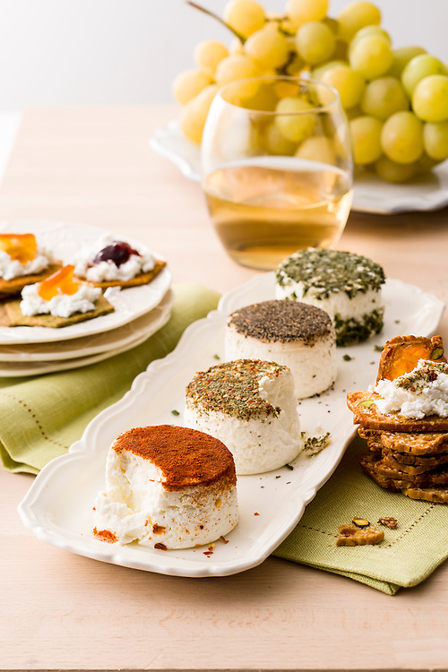 spicy goat cheeses served with bread and white wine