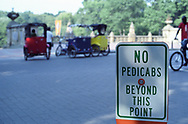 Pedicabs and sign at Bethesda Terrace in Central Park